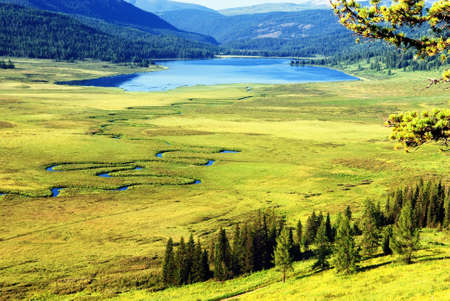 Curved river on meadow and Yazevoe lake in Altai mountains, Kazakhstan Stock Photo - 8951649