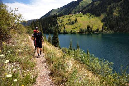 Two mans on the trail along Kolsai lake, Kazakhstan photo
