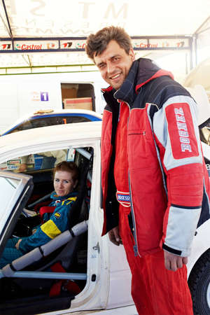 ALMATY, KAZAKHSTAN - APRIL 9: Plyasov and Orlova (11) preparing to start at auto competition