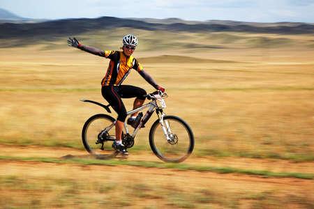 ALMATY, KAZAKHSTAN - APRIL 30: G.Balagurova (N28) in action at Adventure mountain bike cross-country marathon in mountains