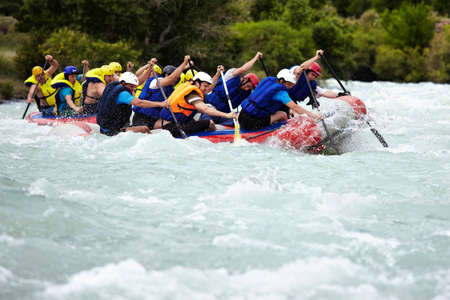ALMATY, KAZAKHSTAN - JUNE 27: Alina team (first boat) in action at Rafting competition on Chilik river. June 27, 2011 in Almaty, Kazakhstan.