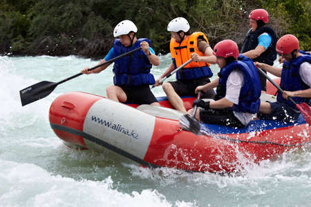 ALMATY, KAZAKHSTAN - JUNE 27: Alina team in action at Rafting competition on Chilik river. June 27, 2011 in Almaty, Kazakhstan.