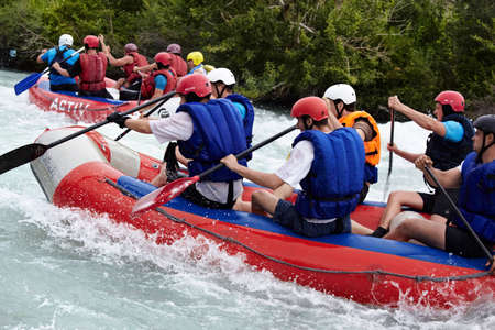 ALMATY, KAZAKHSTAN - JUNE 27: Alina team (right boat) in action at Rafting competition on Chilik river. June 27, 2011 in Almaty, Kazakhstan.
