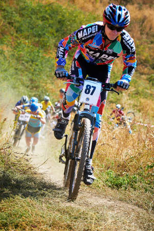 bikecross: ALMATY, KAZAKHSTAN - OCTOBER 16: I.Feodoseev(N87) in action at cross-country mountain bike Apple race October 16, 2011 in Almaty , Kazakhstan. Editorial