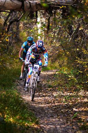 bikecross: ALMATY, KAZAKHSTAN - OCTOBER 16: I.Feodoseev(N87) in action at cross-country mountain bike Apple race October 16, 2011 in Almaty , Kazakhstan. Editorial