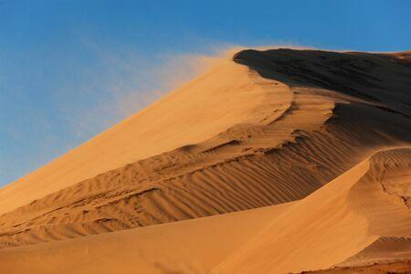 Sand storm on dune in national park Altyn-Emel, Kazakhstan
