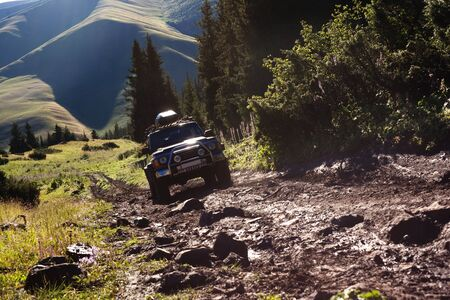 Off-road. 4x4 jeep tries to climb up top of a hill