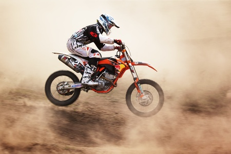 ALMATY, KAZAKHSTAN - APRIL 10: A.Simonenko(1) flies through the air at the Motocross competition