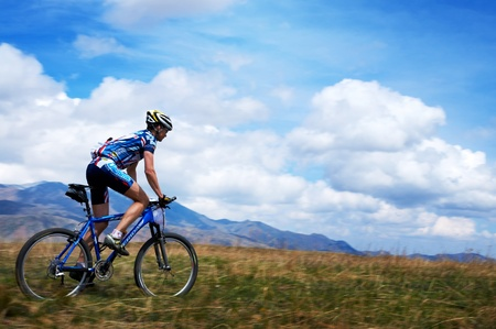 ALMATY, KAZAKHSTAN - APRIL 30: A.Buyanauscas (N19) in action at Adventure mountain bike cross-country marathon in mountains