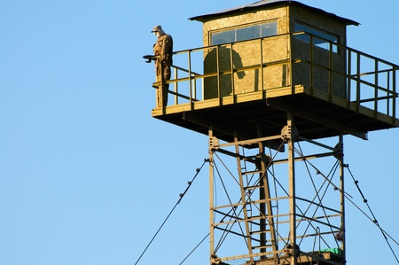 Border Guard watchtower and dummy soldier Stock Photo