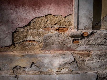 demolish: Old broken wall of the house
