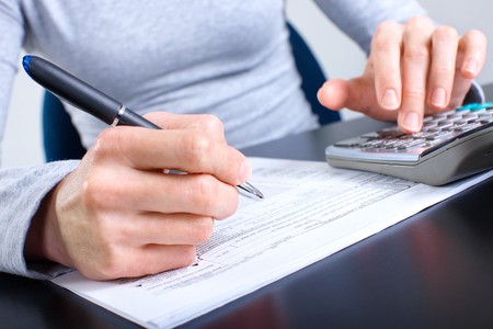 refund: Accountant filling the forms out.