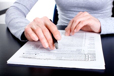 Accountant filling the documents out.  Stock Photo