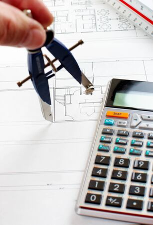 Technical drafting, calculator, construction drawing   photo