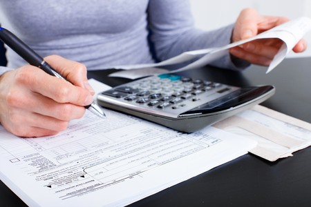 Accountant filling the forms out. Stock Photo