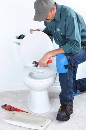 Plumber repairing a flush toilet    photo