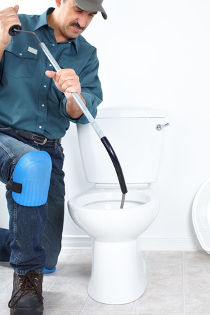 stoppage: Plumber fixing a flush toilet