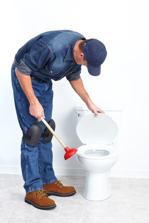 Plumber with a toilet plunger   photo