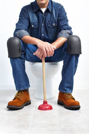 flush: Plumber with a toilet plunger