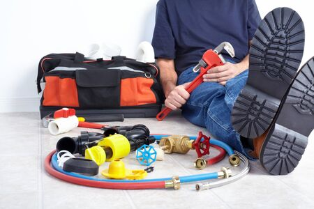 Plumber with tools and details. Worker people