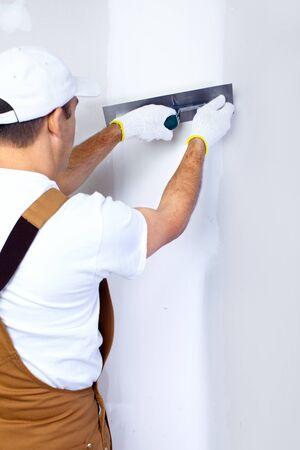 plasterer: Mature contractor plasterer working indoors  Stock Photo