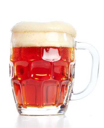 Glass of beer. Isolated over white background  photo