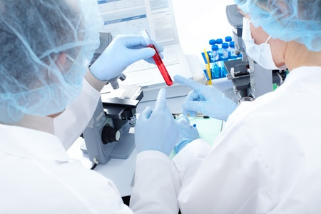 Science team working with microscopes in a laboratory Stock Photo - 8428588