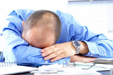 Businessman sleeping in the office  photo
