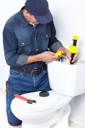 Plumber fixing a flush toilet. Worker people