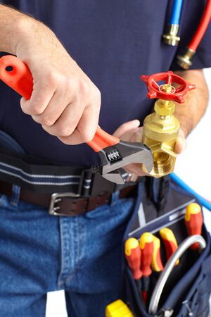 Plumber with tools and details. Worker people  photo