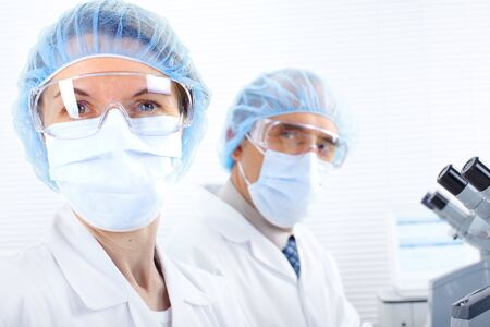 Science team working with microscopes in a laboratory Stock Photo - 8469978