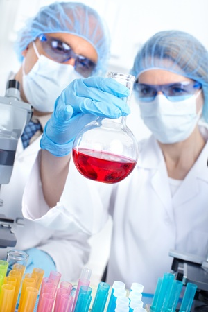 Science team working with microscopes in a laboratory Stock Photo - 8469996