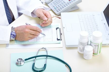 prescriptions: Medical doctor pharmacist working in the office