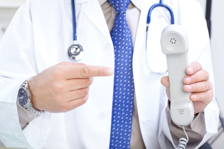 Medical doctor with telephone in the office  photo