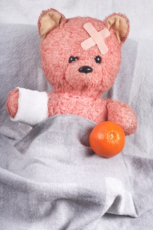 counterpane: The small patient a bear on a white background