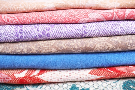 counterpane: Textile fabrics of different colours. Manufactured goods shop Stock Photo