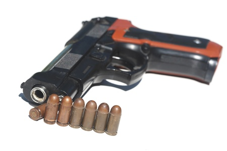 Pistol and ammunition on a white background Stock Photo - 9624507