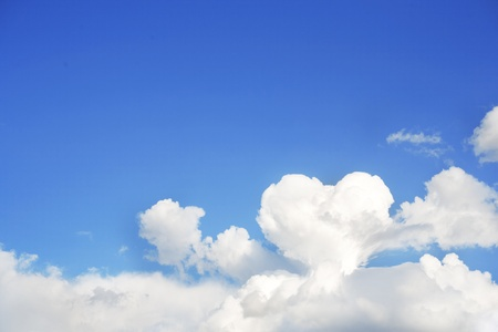 White cloud in the light-blue sky. Heart from a cloud