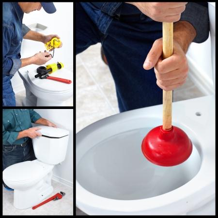 Plumber repairing a flush toilet. Plumber. Worker. Stock Photo
