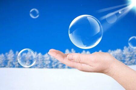 ball aqua: Winter forest. Soap bubbles on a palm. Nature