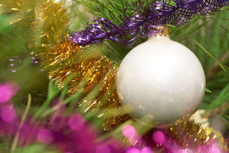 Xmas tree. White glass sphere.  Sparkling tree ornament  photo