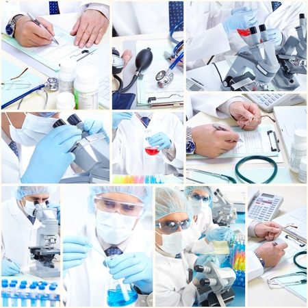 laboratorian: Science team working with microscopes in a laboratory. Stock Photo