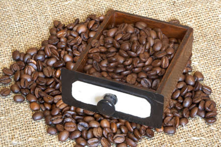 The coffee grains lay in an old box Stock Photo - 12701674