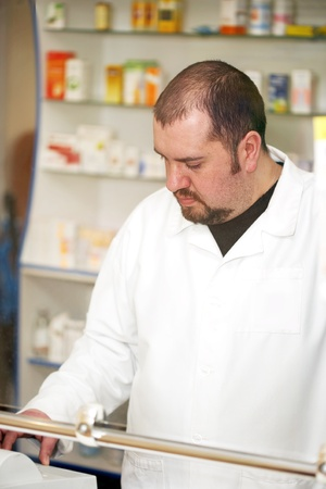 Portrait of a male pharmacist at pharmacy. Selling Stok Fotoğraf