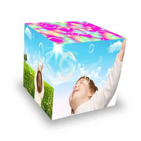 The small girl plays with soap bubbles  Cube photo