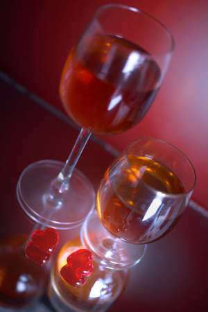 Two hearts and two glasses with wine photo