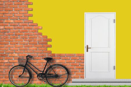 Brick wall and white closed doors. Bicycle near house photo