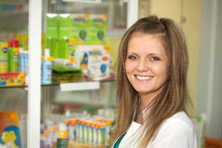 Medicine. Chemist woman standing in pharmacy drugstore  Stock Photo - 13845479