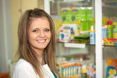 Medicine. Chemist woman standing in pharmacy drugstore Stock Photo - 13845482