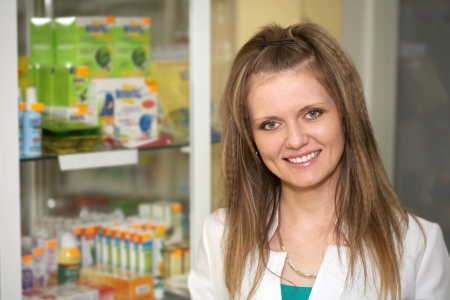 Medicine. Chemist woman standing in pharmacy drugstore  Stock Photo - 13845484